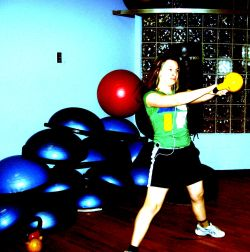 this is my then 12 year old daughter performing two handed swings with an 8kg kettlebell